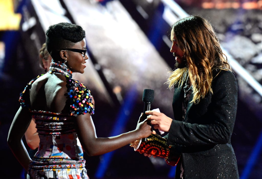 """Jared Leto gave us a flashback to Oscar night when he accepted the MTV Movie Award for best onscreen transformation. Jared's performance in Dallas Buyers Club won him the honour, and he accepted it from Lupita Nyong'o, calling it """"an award in itself"""" to get the trophy from his fellow Oscar winner. In his speech, Jared gave shout-outs to the Rayons of the world and his band, Thirty Seconds to Mars, and also said he's holding out hope that one day there will be an end to AIDS. Earlier this weekend, Jared was among the celebrities enjoying the music festival in the Coachella Valley. On Instagram, Jared shared a video with the caption: """"On the heli from coachella to the #movieawards!!! If I go down make sure @conan knows I love him dearly. Xo @mtv #headwinds.""""  During the show, Jared also asked the audience for a ride back, promising gas money, space in his tent, and great cuddles. We'll have to see if anyone takes him up on it. Scroll down for more photos of Jared!"""