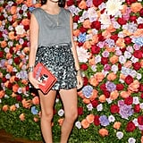 Leandra Medine worked her gams in sequins at the Max Mara accessories campaign launch event.