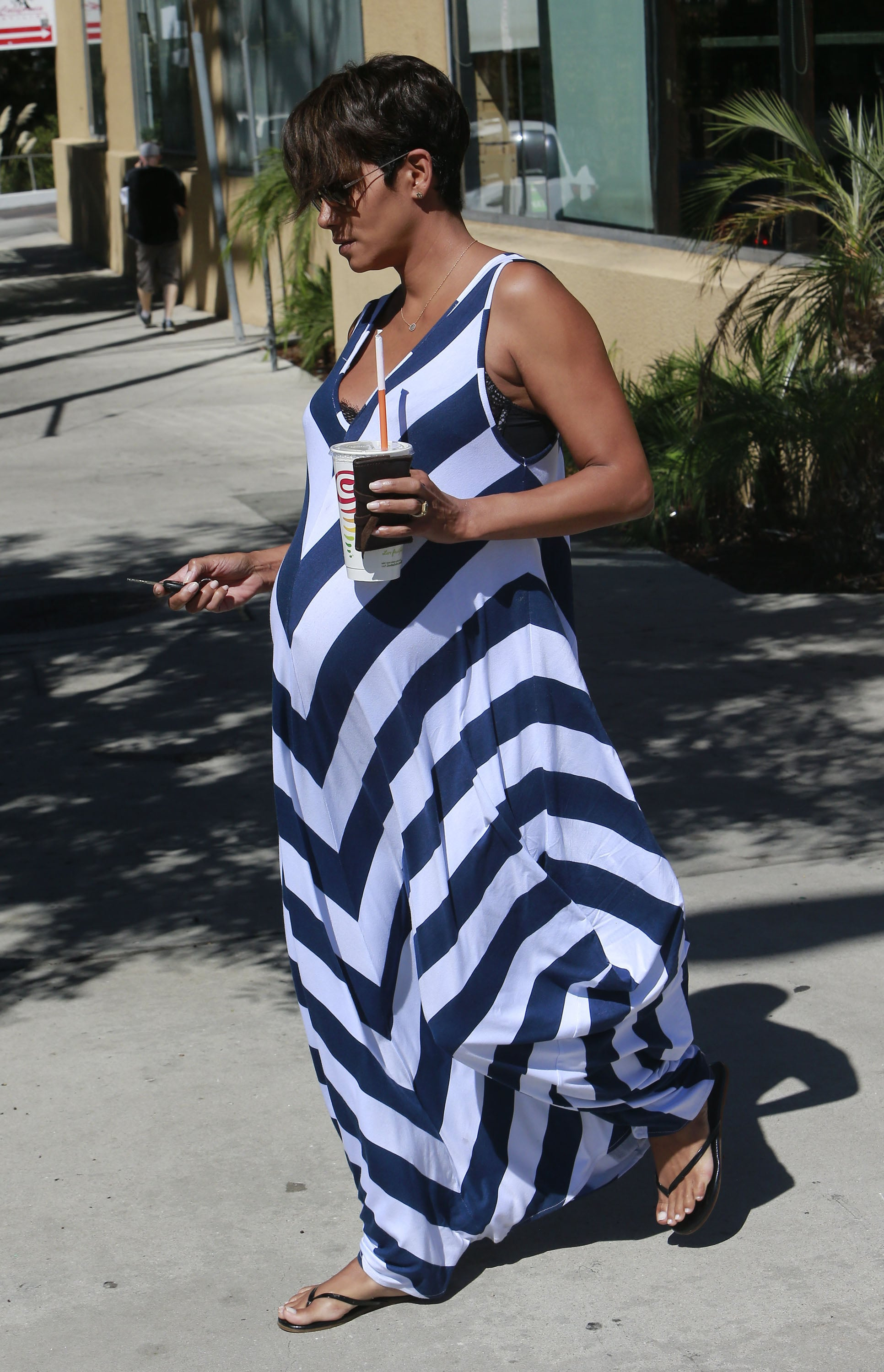 A devoted maxi fan, Halle stepped out in another patterned floor-sweeper, this time with bold stripes.