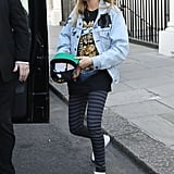 We're not surprised that Cara Delevingne spruced up — and edged up — her vintage denim jacket with black tape, not to mention striped leggings, turquoise sunglasses, and high-top sneakers.
