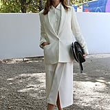 All-white suiting meets eye-catching cage heels for a cool twist.