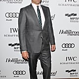 Jon Hamm wore a gray suit with a striped tie.