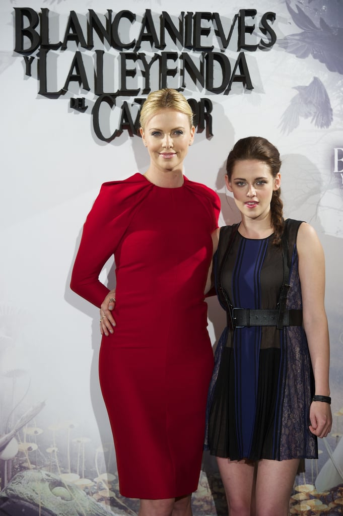 Charlize Theron and Kristen Stewart smiled together at the Snow White and the Huntsman photocall in Madrid.