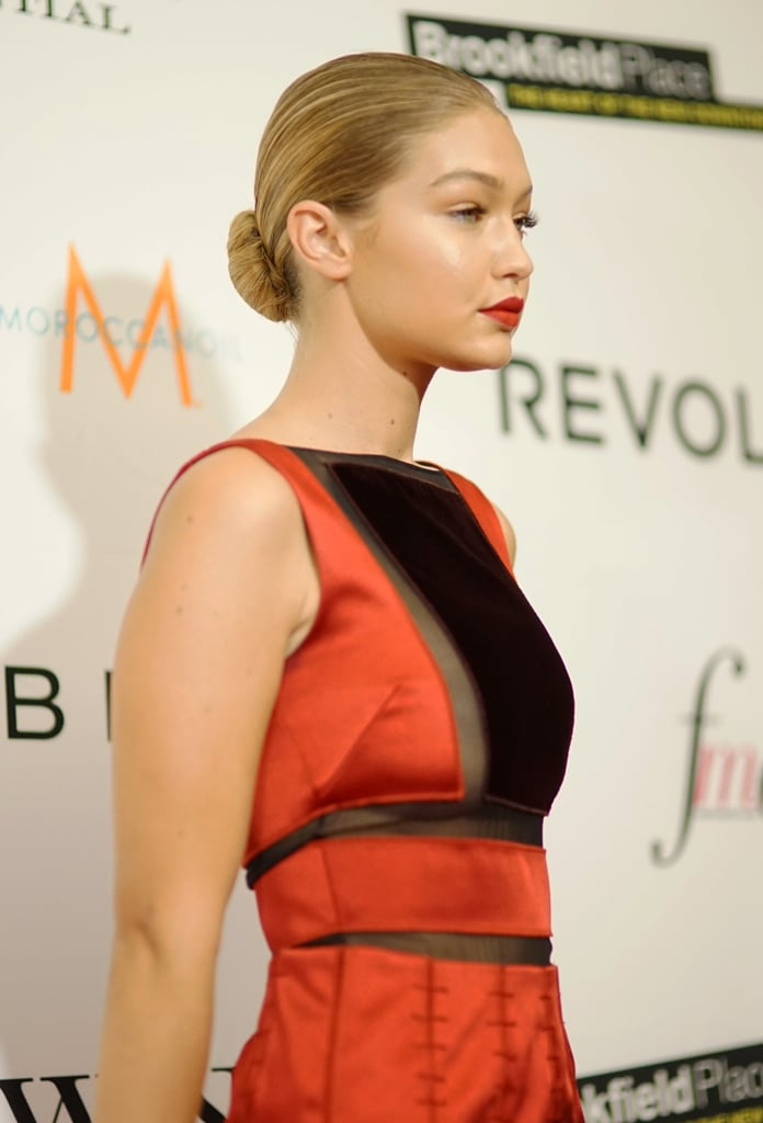 Gigi completed her sexy dress with nothing but a swipe of red lipstick and a sleek bun — so fierce.