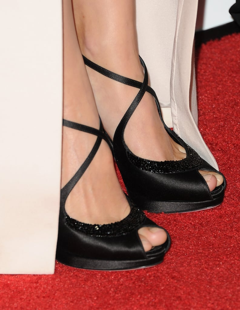 A closer look at Marion Cotillard's black satin Dior sandals.