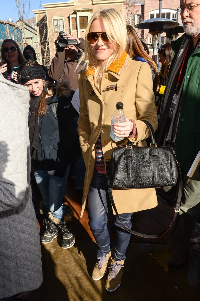 Naomi Watts showed up at Sundance looking cool as ever in a camel-colored toggle coat, matching camel sneakers, and blue leather pants.