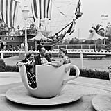 Walt Disney, his wife, Lillian, and their daughter, Diane, take a family ride in the famous teacups at Disneyland.