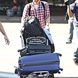 Andrew Garfield pushed his luggage.