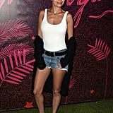 Nicole Richie wearing a white tank top, black cardigan, denim shorts, and Converse at the Nylon Midnight Garden After Dark party.