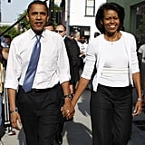 Barack and Michelle walk hand in hand in North Carolina during the 2008 campaign.