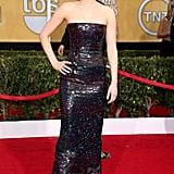 دائماً ما تطل علينا جينيفر بإطلالات متناسقة جذابة، بمثل هذا الفستان المتلألئ بلا حمالة من ديور، الذي ارتدته إلى الحفل السنوي الـ20 لتوزيع جوائز SAG.