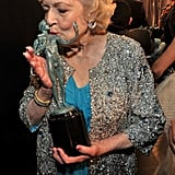 Betty White gave her statue a smooth in 2011.