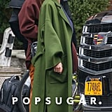 She looked effortless in a green Loewe coat paired with leather loafers.