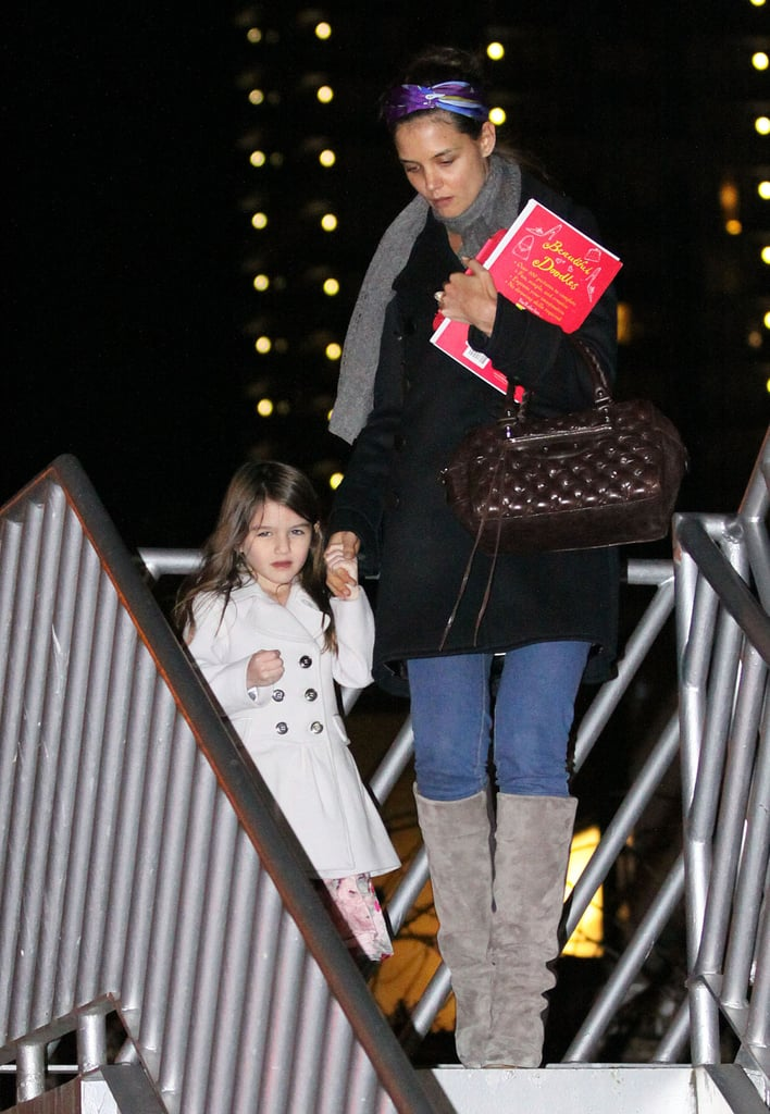 Katie Holmes brought Suri to check out the Stanley Park Christmas train in Vancouver yesterday evening. The girls are up in Canada visiting Tom Cruise, who is there working on Mission: Impossible 4. He showed off his muscles on set earlier this week, reminding us why he earned a spot in our hottest shirtless guys of the year slideshow. Katie wrapped up her own business before heading north to see Tom. She filmed Jack and Jill with an adorable pajama-wearing Suri on Monday, hit the gym in LA on Tuesday, and met with her Holmes & Yang partner on Wednesday. Katie also was up bright and early to announce the Golden Globe Award nominations, sporting a hot Azzaro dress and nouveau Farrah Fawcett hair. Katie may not be making a 2011 award season run, but she does have good news to celebrate. She might be returning to Broadway since she was reportedly offered a part in a show called Extremities.