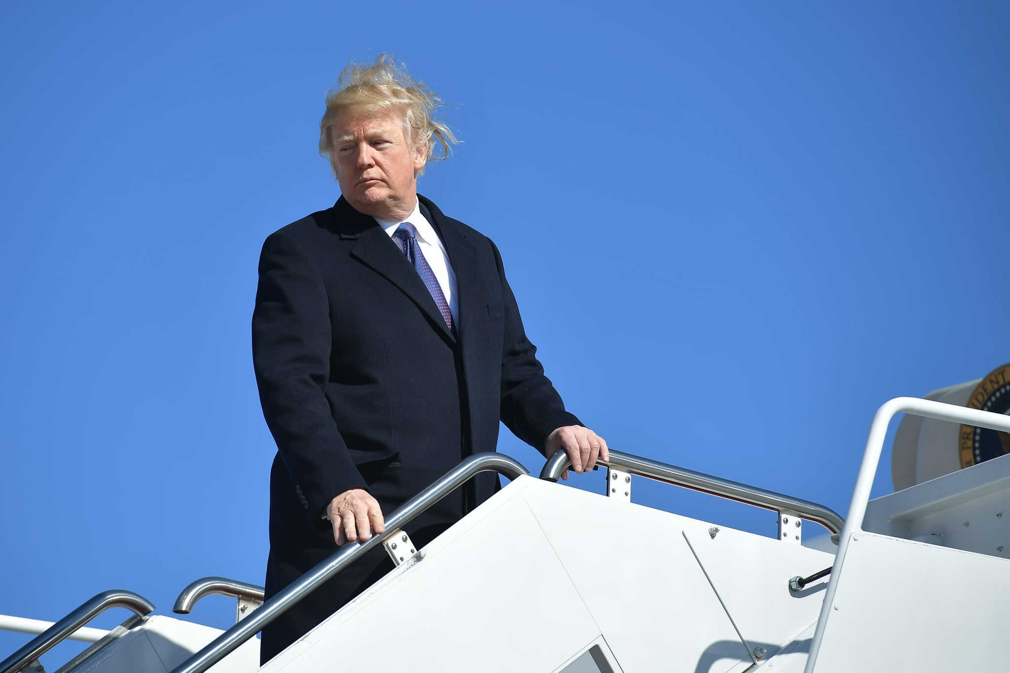 Wind Blows Off Trump's Combover as He Boards Air Force One