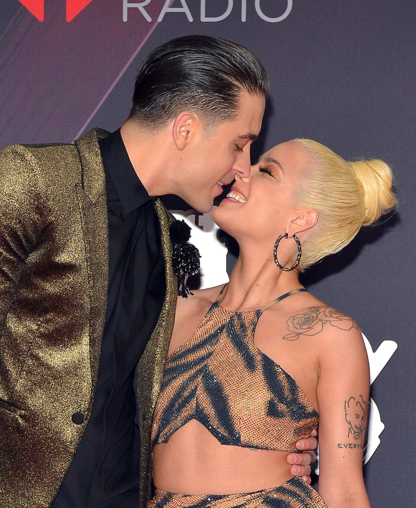 "G-Eazy and Halsey clearly want the whole world to know how crazy in love they are! On Sunday, the couple made a PDA-filled appearance at the iHeartRadio Music Awards in LA. In addition to color-coordinating their outfits, the duo was all about each other as they kissed and posed together on the red carpet. Once inside, G-Eazy joined Cardi B in opening up the show with their hit ""No Limit,"" and the pair even took the stage together to present an award. Keep reading for a look at their night out!      Related:                                                                                                           Holy PDA! Halsey and G-Eazy Can't Stop, Won't Stop Kissing During Their Oscars Date Night"