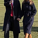 On March 19, Melania walked across the South Lawn with Donald Trump after returning from a trip. She bundled up in a thick navy coat from Chloé and wore a pair of eye-catching cognac-colored boots.