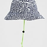 ASOS DESIGN safari hat in abstract leopard print with neon cord