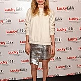 Kate Bosworth dressed for her talk at Lucky FABB in a leather sweater and metallic skirt by Topshop collection.