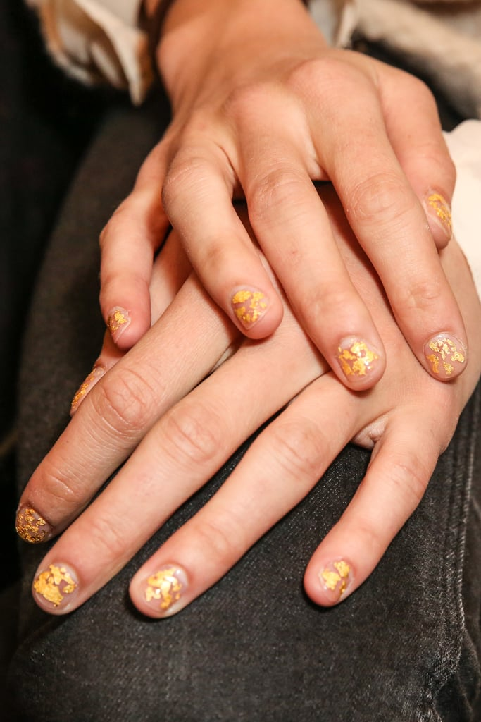 While makeup and hair was basic, the manicure was luxurious. Nail artist Casey Herman used Rococo's 24-karat Gold Leaf ($48) on bare nails. When using glitter and similar top coats, Herman recommends using the brush to scoop out the product and position it on the nail instead of using the traditional brushing technique.