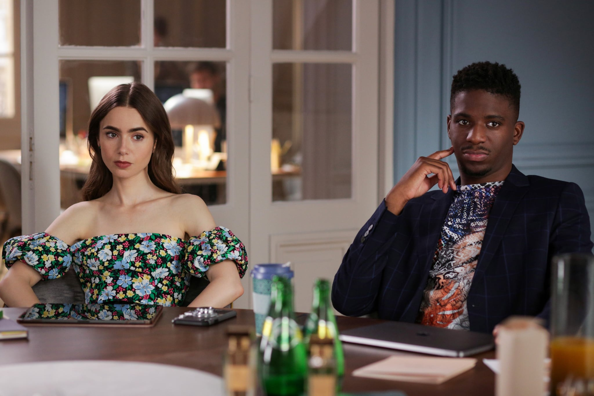 EMILY IN PARIS, from left: Lily Collins, Samuel Arnold, (Season 1, ep. 103, aired Oct. 2, 2020). photo: Carole Bethuel / Netflix / Courtesy Everett Collection