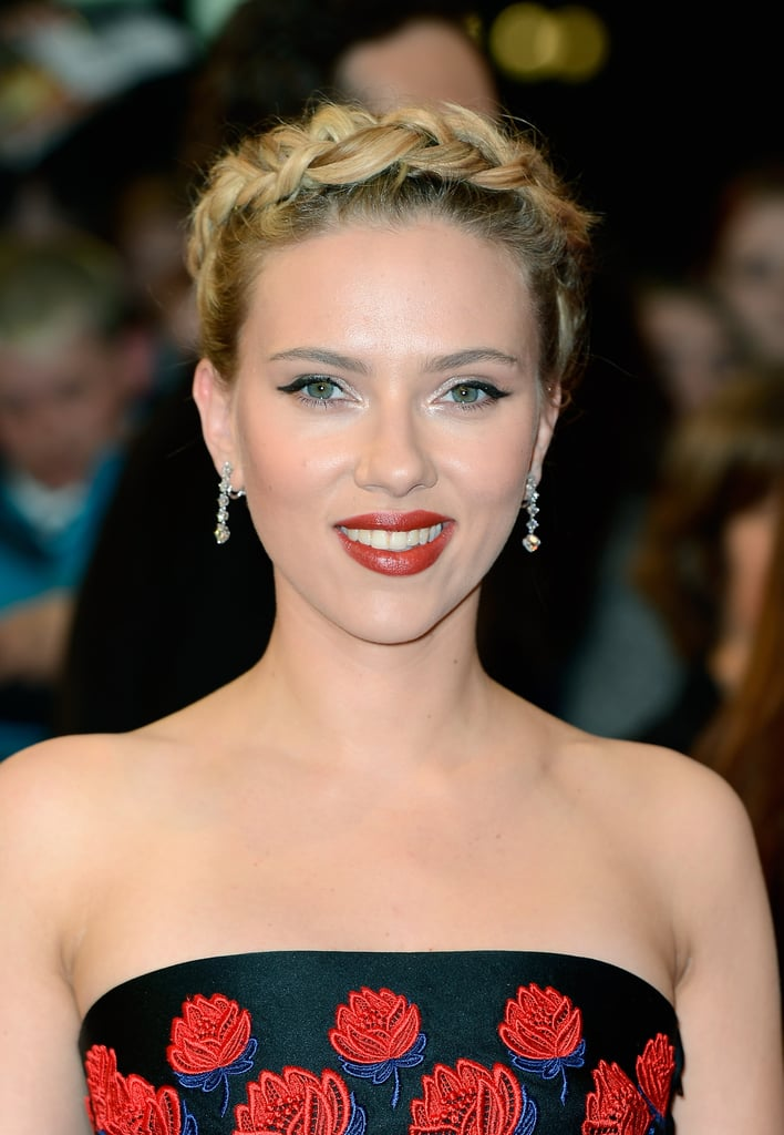 Scarlett Johansson gave a red-lipped smile at the premiere of The Avengers in London.