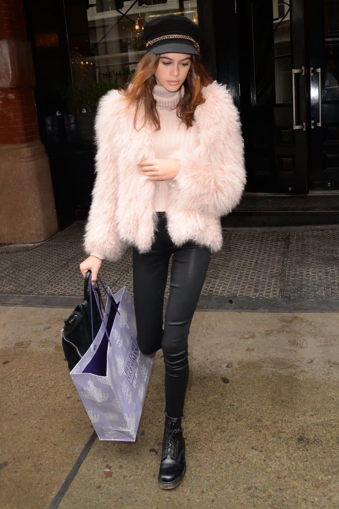 There's more of that hard/soft mix that Kaia seems to favor! While out in NYC with her mom, she paired Dr. Martens and J Brand leather pants with a fuzzy pink Pam & Gela coat and matching pink turtleneck. And don't even get us started on that hat.