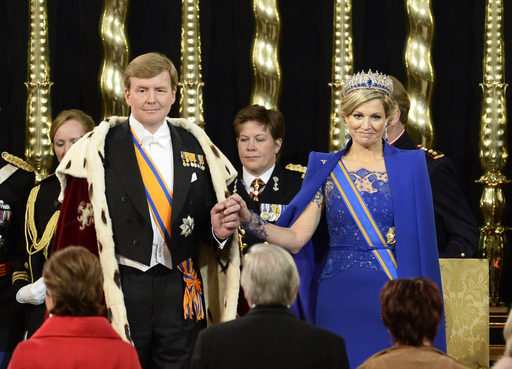 The Dutch king and queen stood in front of members of the States General and the States of Aruba, Curacao, and St. Maarten as they swore an oath during the swearing-in and investiture ceremony.
