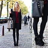An all-black palette gets a rich seasonal addition via a cozy, cranberry sweater.  Photo courtesy of Lookbook.nu