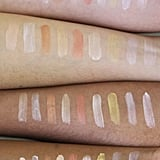 NYX Cosmetics Away We Glow Liquid Highlighter Swatched on 4 Skin Tones