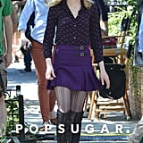 Emma Stone filmed a scene for The Amazing Spider-Man 2 while wearing a purple skirt in NYC on Wednesday.