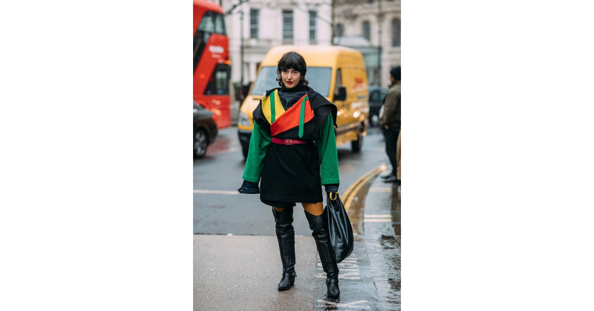 59544c6d1ab A Fashion Week guest wore her rainbow coat with over-the-knee boots ...