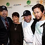 Mark Wahlberg with his brothers Donnie and Paul, and his mother, Alma Elaine, at the grand opening of Wahlburgers.