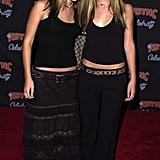 Twinning combo: At a 2001 Jive Records event, the girls mirrored each other's style with nameplate chokers, embellished belts, and strappy sandals.  Mary-Kate styled her black tank with a sheer-panel skirt and Western-inspired belt. Ashley accessorized her black halter and low-slung trousers with a printed Gucci belt and matching tote.
