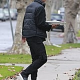 Gavin Rossdale headed into a friend's home with his family.