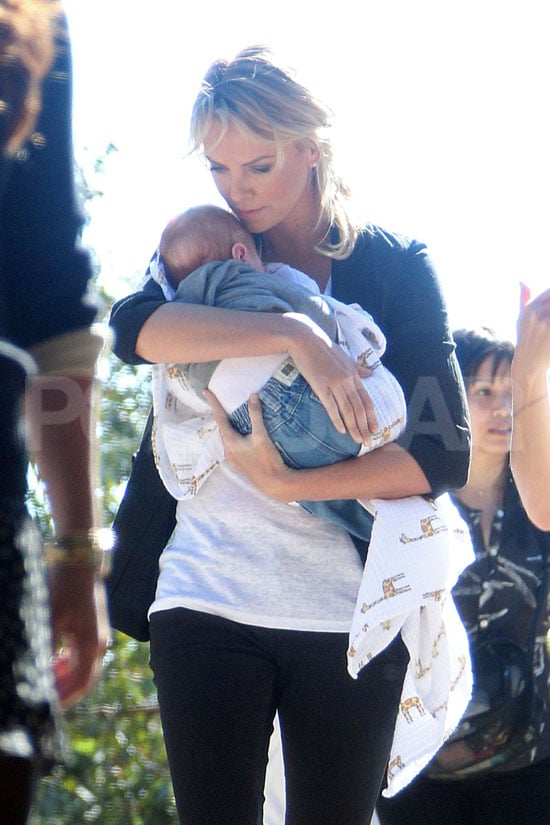 Charlize held on to a friend's baby.