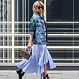 Bring your ruffled Summer skirt into Fall when you throw on your denim jacket, and ground out the look with combat boots.