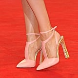 Her peach-and-gold pumps provided a structural edge to her girlie Elie Saab Couture dress.