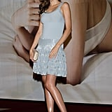 At a press conference in Seoul, Miranda Kerr stuck to a cool-hued colour palette in an embellished Azzedine Alaïa dress and laser-cut pumps.