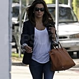 Eva Longoria with a brown leather bag.