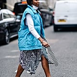 Winter Outfit Idea: A Puffy Vest With a Midi Skirt