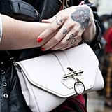 We love the heavy metal hardware juxtaposed with a clean white bag.