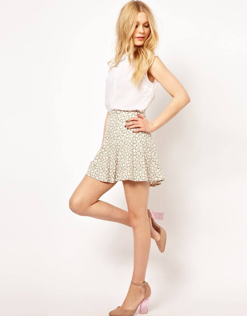 Style River Island's animal burnout skater skirt ($33) with Keds and a slouched tank for an effortless weekend look.