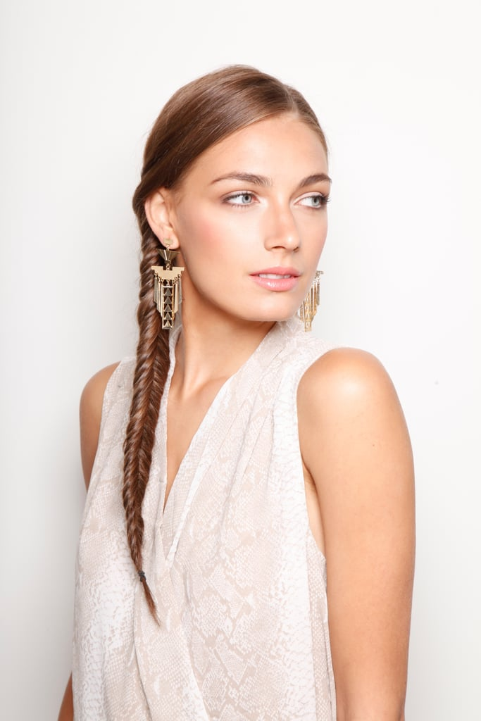 Sideswept hair calls for dangling earrings like these Gold Osiris Earrings ($24). Try an over-the-shoulder ponytail, waves, or a fishtail braid, as seen here.
