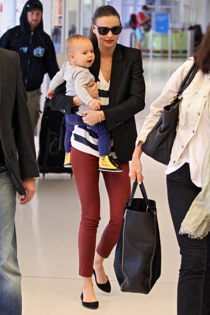 Red pants, stripes, and a sleek blazer make the sophisticated of travel looks.