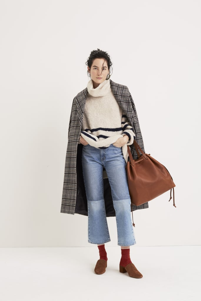 Madewell plays with proportions with this oversize turtleneck and cropped flare jeans.