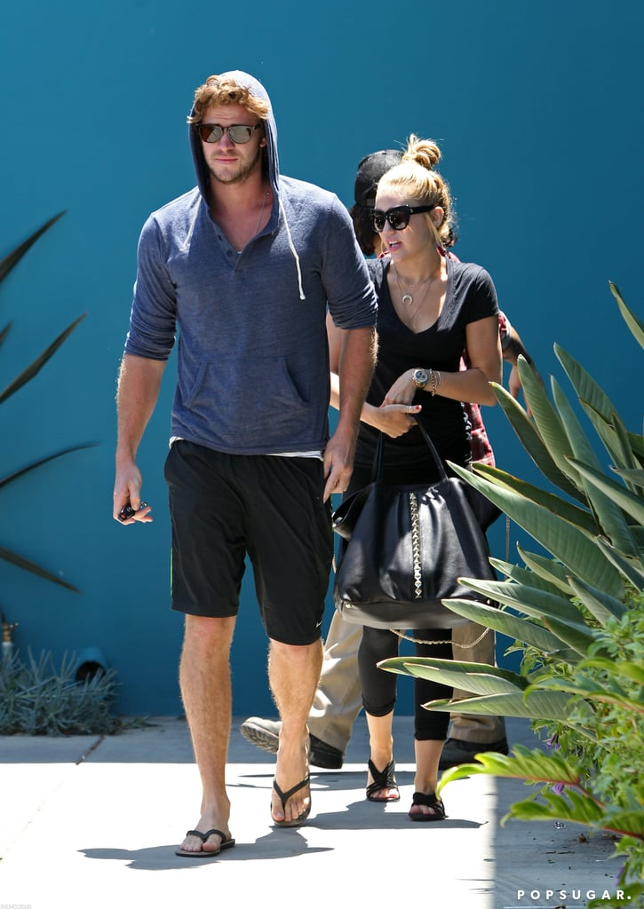 """Miley Cyrus and her fiancé, Liam Hemsworth, checked out a Pilates class in LA yesterday. The duo have been spending a great deal of time side by side lately, whether out at an exercise class or taking their skateboards for a spin in their neighborhood. The together time comes after Liam was away for a bit shooting Empire State, and Miley focused on her own upcoming album. Miley also found an opening in her schedule to work on a project with a sibling —Miley's in her brother Trace's new video for the song """"Sippin on Sunshine."""" Another of the Cyrus kids, Braison, was in the news this week after their dad Billy Ray tweeted a photo of him in a hospital. Eighteen-year-old Braison Cyrus is OK after suffering complications from a tonsil extraction surgery."""