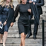 Moss looking every bit a supermodel while leaving Peter Lindbergh's funeral in a black mini-dress.