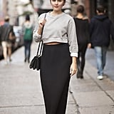 Give your maxi skirt a seasonal finish with a cozy sweatshirt top and booties. Source: Adam Katz Sinding