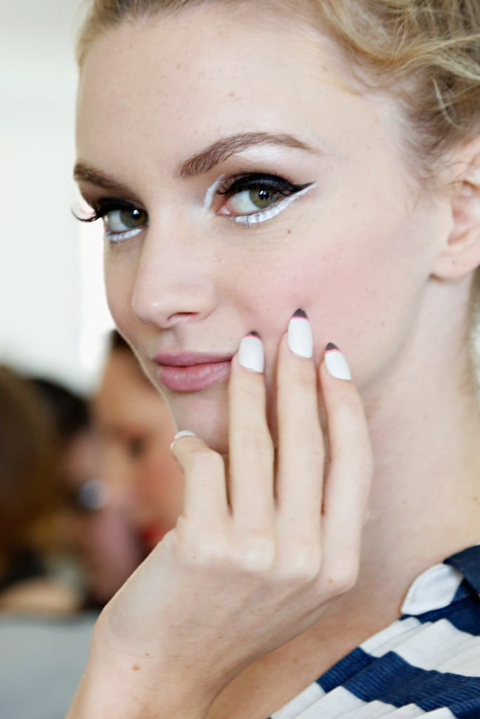 Graphic white eyeliner at Kate Spade.